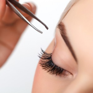 Woman eye with long eyelashes. Eyelash extension. Eyebrow
