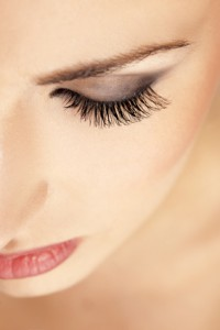 female eyebrow and eye with false eyelashes